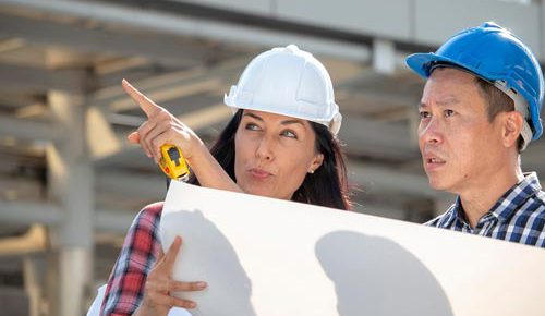 engineer-woman-is-pointing-for-project-manager-to-see-building_t20_axQ2rp.jpg